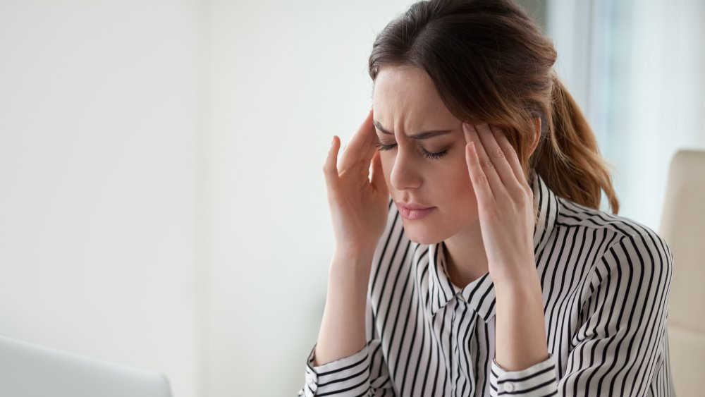 Why does tying my hair give me a headache?